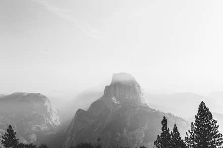 view from Glacier Point in Yosemite on a foggy morning in black and withe photo