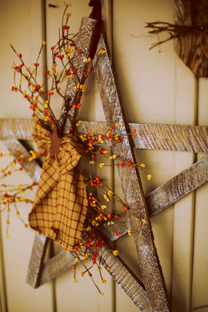 decore: Rustic hand made christmas star decoration hanging on wall Stock Photo