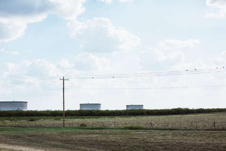america countryside: Feild with three water tanks in the Texas countryside, America Stock Photo