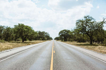 indefinite: Infinate straight road in Texas countryside, America Stock Photo