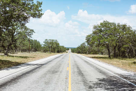 indefinite: infinate straight road in Texas countryside, America