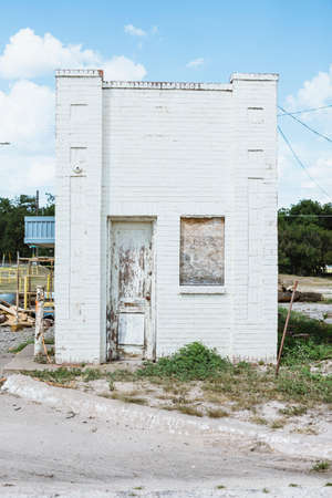 america countryside: Weathered abbandoned brick building in the Texas countryside, America