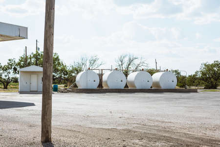 four gas tanks outside in Texas countryside, America