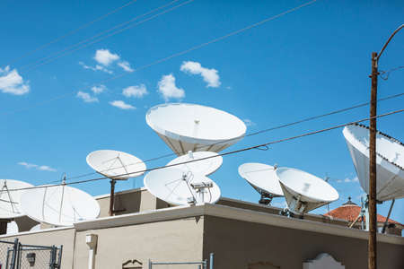sattelite: Sattelite dishes on a roof of a building in El Paso, Texas Stock Photo