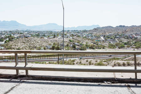 Cityscape of El Paso from the highway, withountains in the background photo