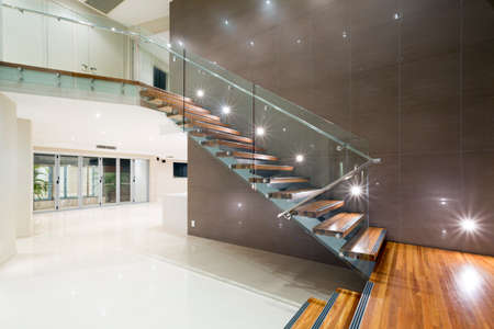 Contemporary mansion with wooden staircase