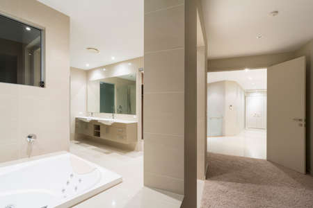 Bathroom with spa in large Australian mansion photo