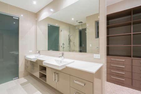 Spacious contemporary bathroom with walk in wardrobe photo