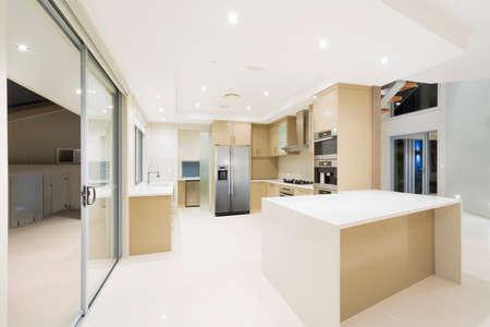 stainless steel kitchen: Modern kitchen with stainless steel appliances in Australian mansion