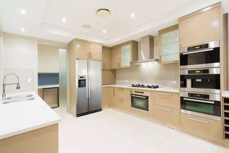 fridge: Modern kitchen with stainless steel appliances in Australian mansion