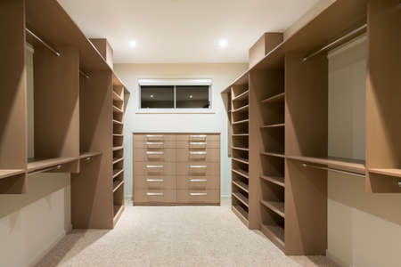 Big empty walk in wardrobe in luxurious house photo