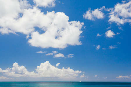 infinite: Infinite blue sky with white clouds above the Caribbean sea Stock Photo