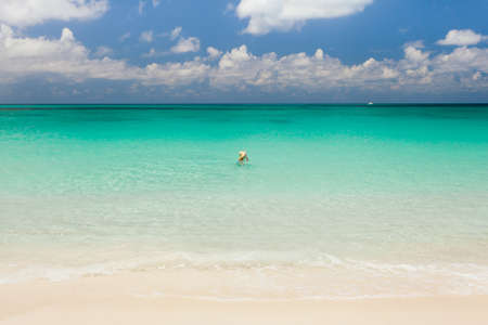 Tourist swimming in crystal clear Caribbean sea photo