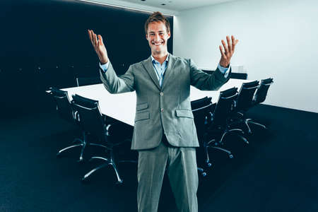 Happy business man in contemporary Conference room