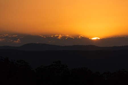 A beautiful sunset over the Sunshine Coast hinterland.  Located at Mapleton Falls, QLD, Australia. Stock fotó