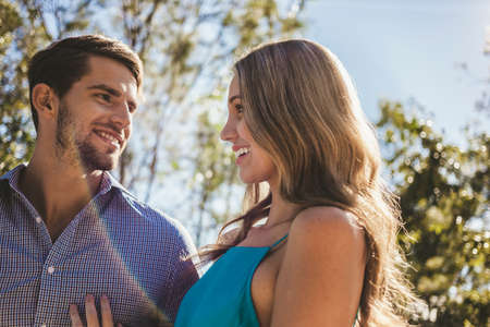 Young caucasian man and woman smiling on a sunny day in the backyard. Stock fotó
