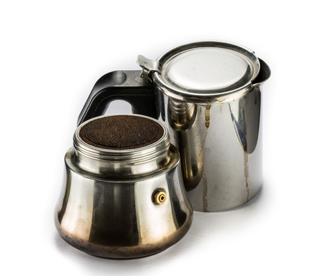 grinded: Finished moka pot and grinded coffee on a white table Stock Photo
