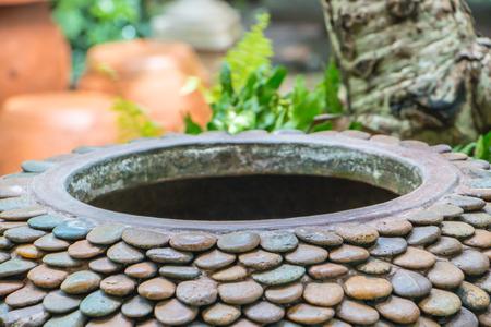 gigantesque: Gigantic jar, Warer jar with stone pattern in the garden