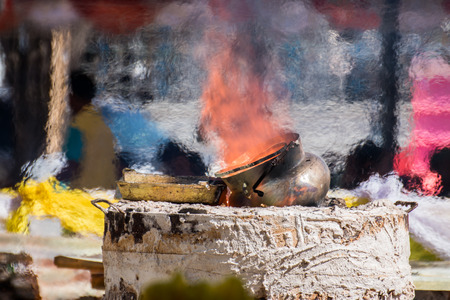 metal casting: the molten metal for Casting of Buddha statue