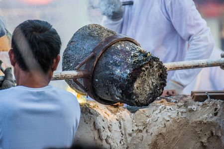 molten: Molten Gold being poured into Buddha statue moulds