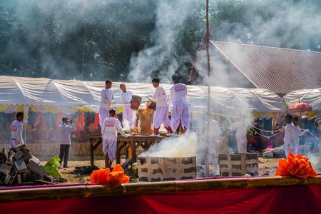 crucible: BURIRAM THAILAND - JAN 2 : Buddhist metal cast ceremony for buddha statue , Pouring molten metal in mold . Jan 2,2017 in Lok Molee Temple, Buriram, Thailand.
