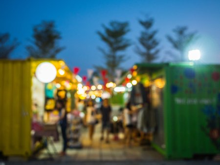 Abstract Blur Food Stall at street night market with bokeh for background usage Stock Photo