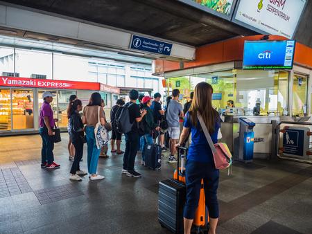 BANGKOK, THAILAND - MAY 6,2017 : Unidentified passengers waiting for coin change at BTS Skytrain Phayathai Station on May 6, 2017 in Bangkok, Thailand.