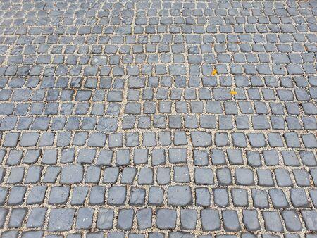 Ziegelbodenfliesen in der städtischen Straße, im Bauwesen und in der Architektur
