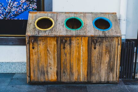 Garbage Trash Bins wooden. Recycling bins at a recycling station Recycling, translate is General waste, Plastic, Can,Glass