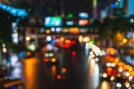 The Beautiful background on dark, out of Focus Lights during the Night. Car traffic