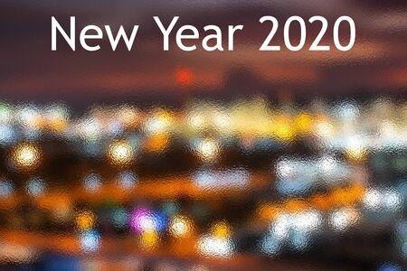The Happy New Year 2020 With Dark Navy Blue Glitter Bokeh Light Sparkling Background,holiday Celebration Stock fotó
