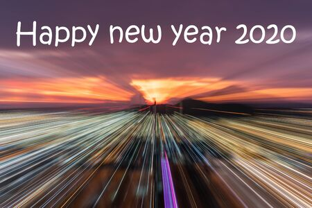 The Happy new year 2020 text on Smooth Running focus to coastal city on colorful cloudy sky background in twilight time