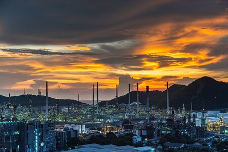 The Oil refinery and petrochemical plants Steel pipe equipment at sunrise background Stock Photo