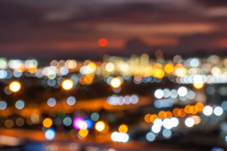 colorful bokeh lights from lamp over city, in vintage film color style