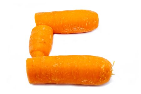 The C is a carrot. Bright capital letter C made of round carrot slices at white background