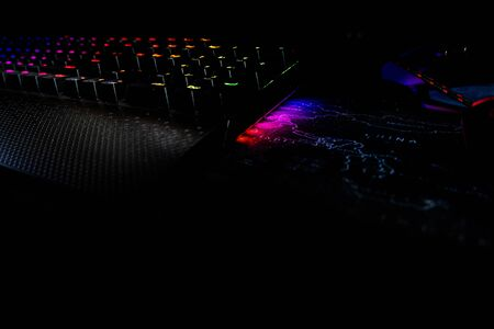 The Back lighted computer gaming keyboard with RGB gradient colors, black space for putting text Фото со стока