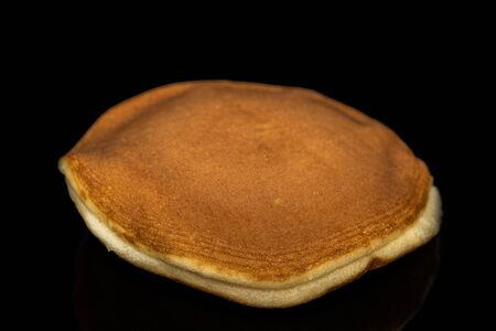 The Dorayaki , Japanese traditional red-bean pancake dessert isolate on black background