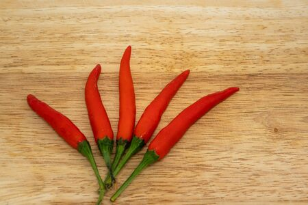 The Red Hot Chili Peppers Over Wooden Background