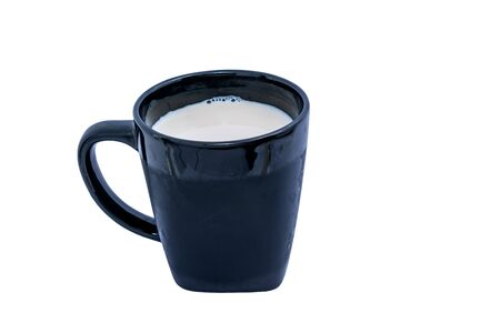 A black Glass of milk on white background. Healthy beverage concept.