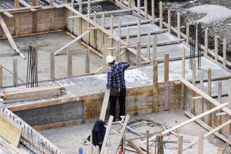 civil construction: Carpenter at work on site