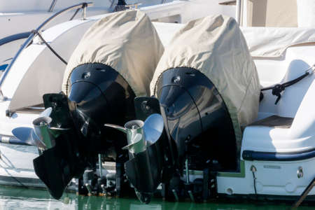 outboard: Couple of outboard engines with cover