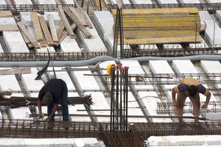 Turin, Italy 10 May 2013: skilled workers are preparing the reinforcing frame for new city palace Editorial