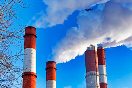 Chimneys with steam production of a thermal power station Archivio Fotografico