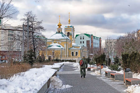 transfiguration: Moscow, Russian Federation - January 21, 2017 : Located in Transfiguration Square view of  Church from adjacent garden covered by snow , the surrounding buildings and local traffic