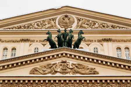 frequented: Moscow, Russian Federation - January 28, 2017. Bolshoi Theater pediment detail, view of the bronze chariot created by Pyotr Klodt.This theater is very famous Throughout the world and its Frequented by many tourists.