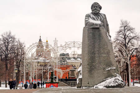 Moscow, Russian Federation - January 28, 2017: Karl Marx Monument covered by snow with big incision: proletarians of all countries, solidarity! - Sculptor Lev KerbelIt's located in Teatralnaya Square. Editoriali