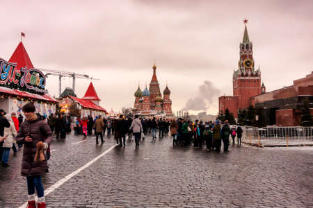 Moscow, Russian Federation - January 21, 2017 : View from Red Square, on the right the Lenin s Mausoleum and  Spasskaya tower, forward the  St. Basil s Cathedral. Editorial