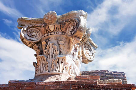 Ancient Roman capital close up in archaeological excavations of Ostia Antica - Rome - Italy