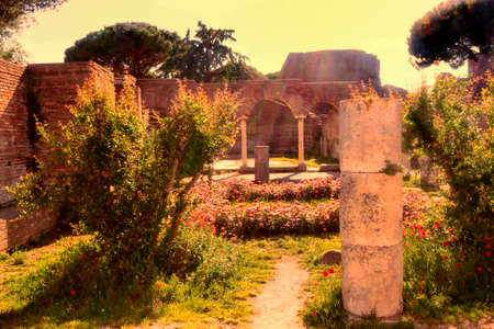 archaeological sites: Sunset glimpse of the ruins of Domus della Fortuna Annonaria - a rich house in the archaeological area  of Ostia Antica - Rome Stock Photo
