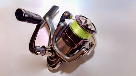 Spinning reel mounted with yellow thread